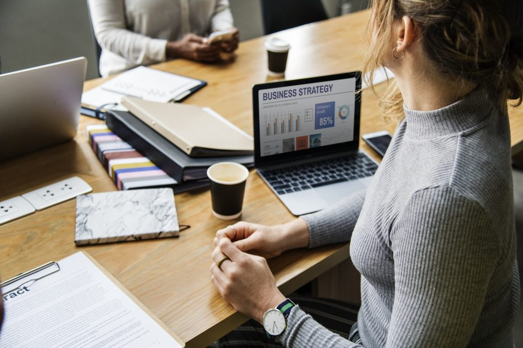 woman at desk with business strategy on computer